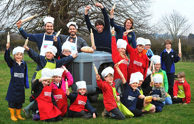 Schoolchildren join Alex James and Tom and Henry Herbert at the launch of the Big Feastival's Wheat Project. Picture © Oxford Mail